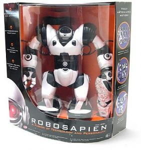 """A photograph of a Robosapien, similar to the one pictured in figure 14.1, in its original packaging on a white background. The front of the package says """"Robosapien; A Fusion of Technology and Personality.�"""
